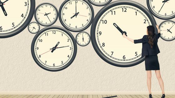 Women touching big clocks