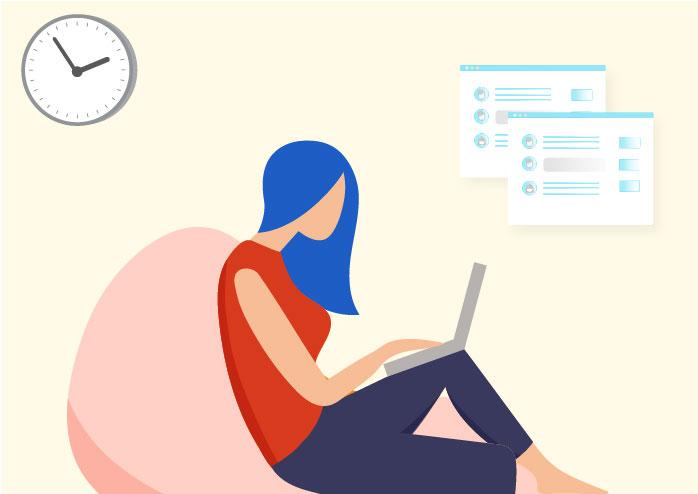 Women sitting on beanbag using laptop